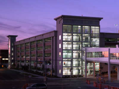 John P. Stopen SUNY Upstate Parking Garage exterior at night
